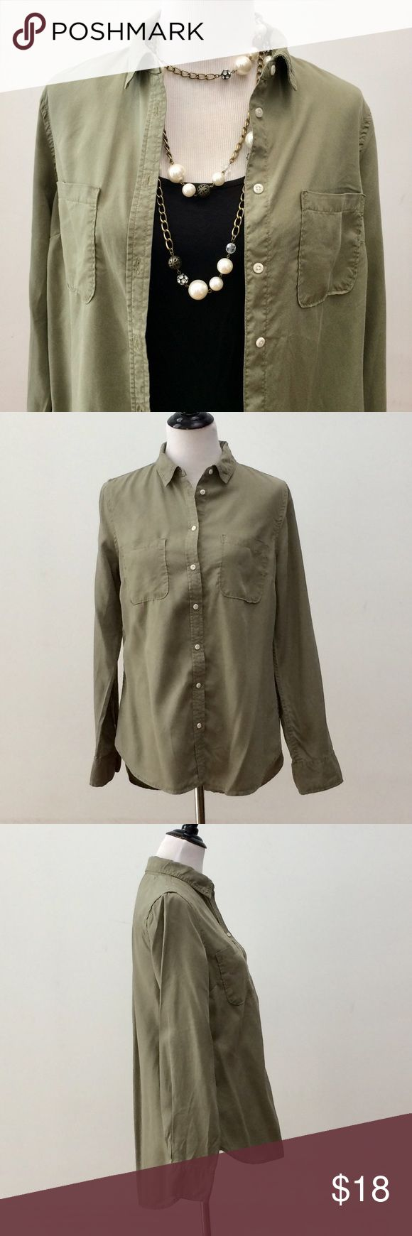 """Merona Button Down Shirt Size M Merona brand button down shirt size medium. Army green color. High collar option. 2 front pockets. 8 buttons. 3 button closure on sleeves.   100% Lyocell.   Approximate measurements:   Bust = 40""""  Sleeves = 25""""  Length = 28"""" (front & about 2"""" longer on back)  Very good condition w/minor markings (see photos w/pink pen).   Open to offers.   Thanks! Merona Tops Button Down Shirts"""