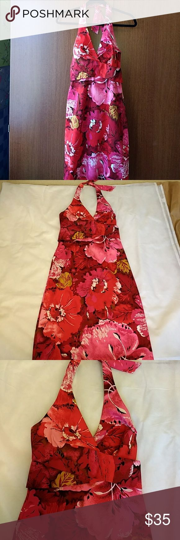 Beautiful Donna Ricco Floral Print Halter Dress. Beautiful Donna Ricco Floral Print Halter Dress perfect for summers. As shown in the picture, slight pulling near the zip. It can easily be repaired, not noticeable. Donna Ricco Dresses