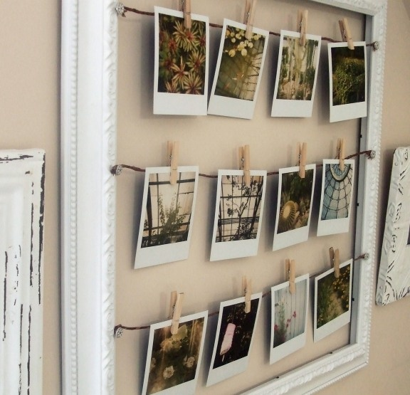 what a clever way of hanging your Polaroids... genius!!!