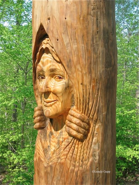 Tree Stump Carving of Fairies | Woman and raccoon carved in an 8 foot tree trunk. Not available.