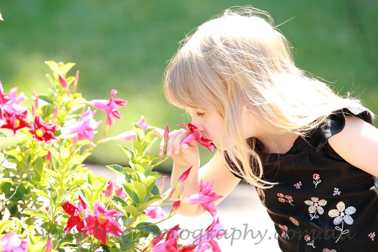 Smelling the flowers - Brisbane Outdoor Lifestyle Family Photography