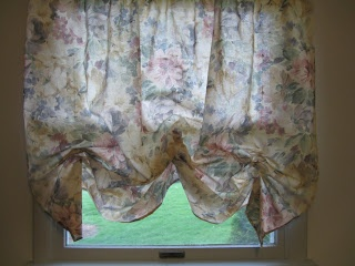 DIY balloon shades. Shows how to transform curtains into  movable shades.