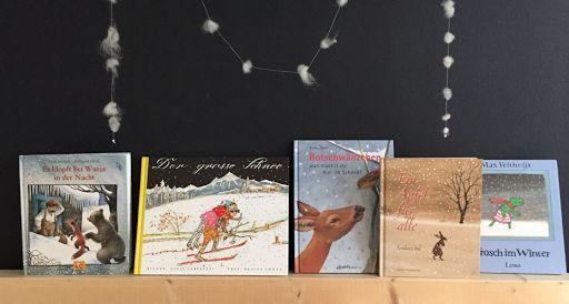 AprèsSchlitteln für die Kleinen: Sich wieder aufwärmen bei Kakao und Geschichten.  Hier unsere Winterbücher, heissgeliebt: