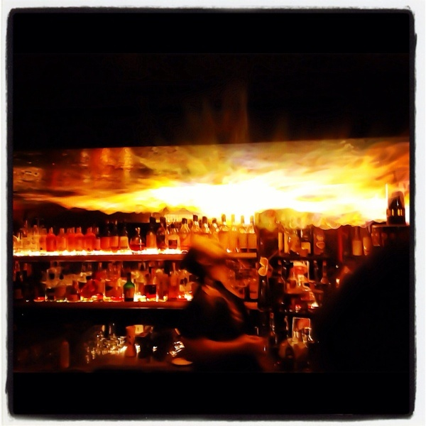 The bartender literally setting to roof alight at Trailer Happiness, Portobello Road, Nottinghill, London, England...