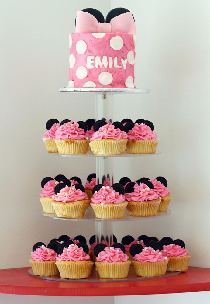 Minnie Mouse Disney ears pink smash cake and cupcake tier. Made by CupCasions Kelowna.
