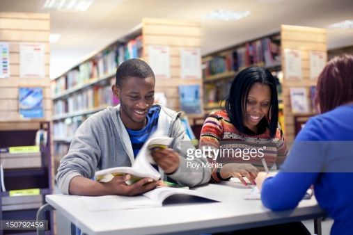 Stock Photo : young people in a college library
