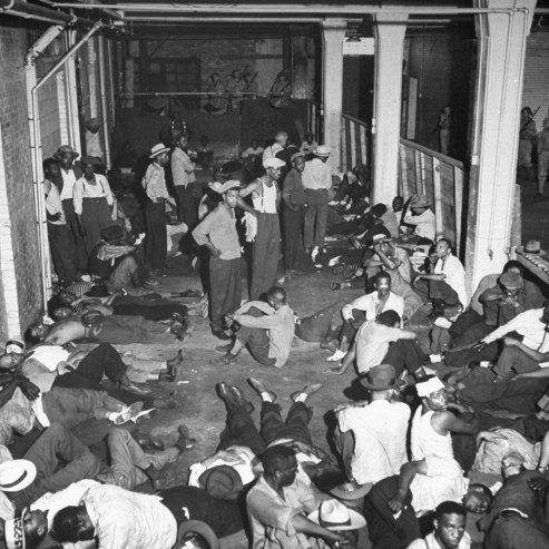 African American men rounded up under U.S. Army guard following wartime race riots in Detroit, June 1943.