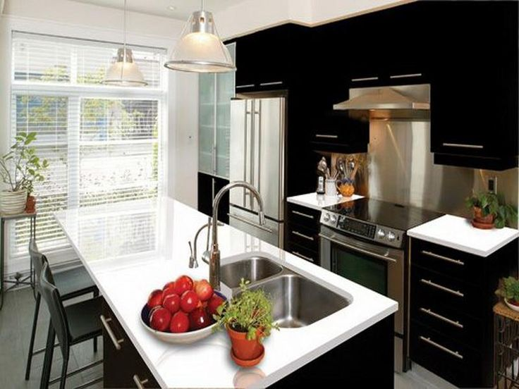 Arctic White Quartz Countertops I think I like this look the best. Dark cabinets with this type hardware and then lighter quartz counter tops