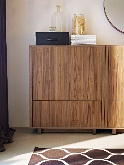 Push openers give this cabinet a streamlined look with no handles or knobs needed. The STOCKHOLM collection, 2013.