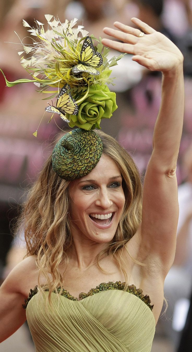 """SARAH JESSICA PARKER in A Flamingo Healthy """"hat""""-- uniquely fruitly a la Philip Treacly of the UK.   Google Image:  http://cache.gawker.com/assets/images/gawker/2008/05/81068561.jpg"""