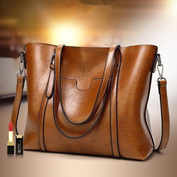 3 for 2 OFFER! Add 3 bags to cart and apply discount code: TOTE2018 I don't care much for fast fashion.I prefer classics that have withstoodthe test of time. If you resonate with the above statement, then this bag is for you. Check out our classic Leather Tote Handbag. It's got the timeless elegant vibe written all over it. This bag is definitely a MUST HAVE! This is the classic leather tote handbag. These unique styles of bags will definitely step up your fashion game! It's p...