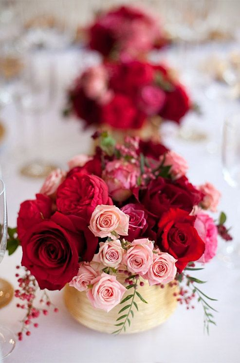 A mix of lush red roses and pink tea roses make the perfect centerpiece for a garden party. Wedding Flowers, Wedding Décor, Roses, Centerpieces