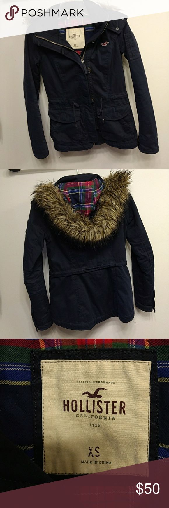 Navy Hollister coat Like new Hollister coat.  One of the buttons on the pocket has come apart.  See picture above Hollister Jackets & Coats