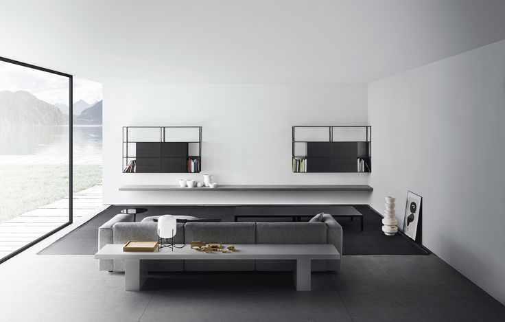 Minimal but emotional living space with MDF Italia furnitures. Here you can see Mate 2012 sofa, minima bookcase system and link bench and shelve.