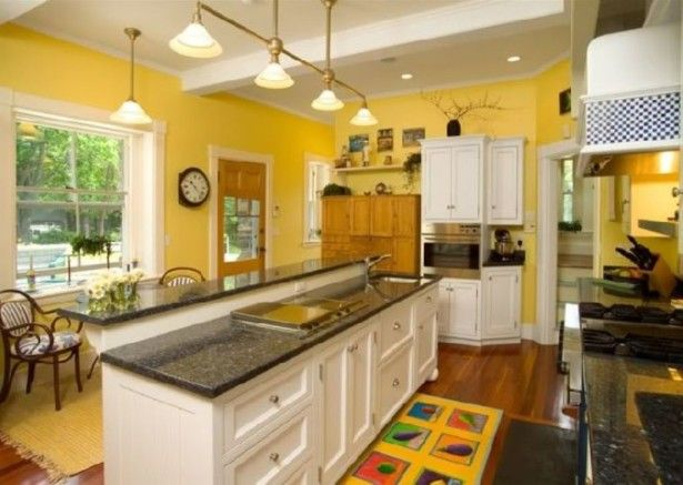 wall colors for white kitchen cabinets black countertops with yellow