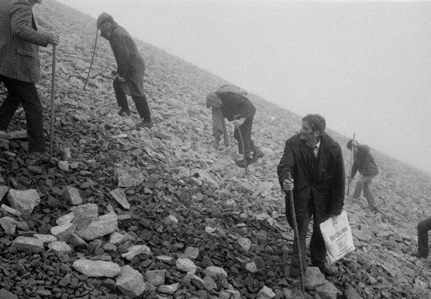 (c) Magnum Photos.  Martin Parr.  COUNTY MAYO, Ireland—On the last Sunday of July, thousands of people climb Croagh Patrick for Ireland's most important pilgrimage, 1983.