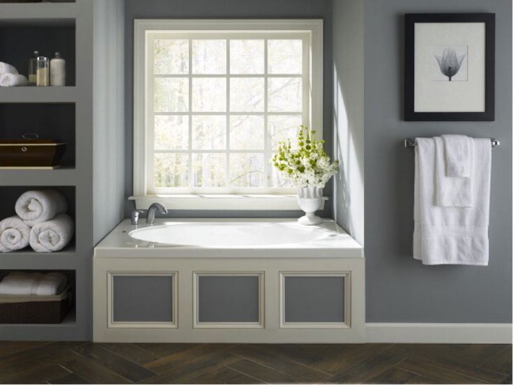 Built in shelves and a jacuzzi whirlpool tub add a modern for Whirlpool bathroom designs