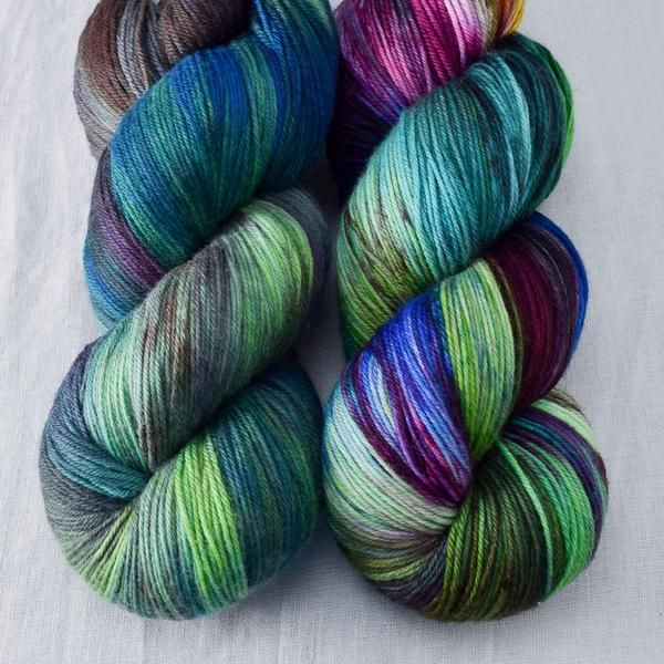 Zombie Games is beautifully dark, blue and green with purple and pink, and a little brown where the colors blend together. This colorway can be highly variable, so feel free to give us a call for a cu