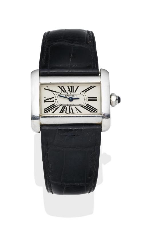 A Lady's stainless steel Tank Divan wristwatch, Cartier, circa 2005. Quartz. 32mm. Ref: 2599. Rectangular case with cream dial and painted black Roman numerals. Case, dial and movement signed. Original black leather strap and buckle. Original box and papers. - Price Estimate: $1200 - $1800