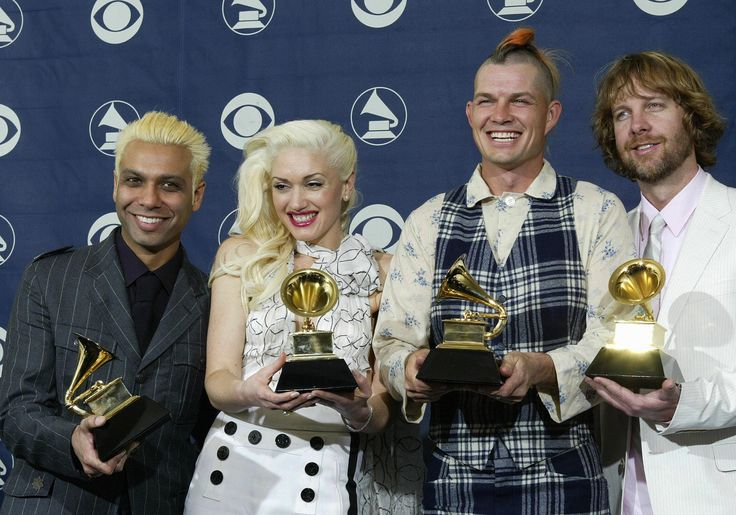 LOS ANGELES, UNITED STATES:  Gwen Stefani (2L) and her group 'No Doubt' hold their Grammy award in the Best Pop Performance By a Duo or Group with Vocals category during the 46th Annual Annual Grammy Awards 08 February 2004 at the Staples Center in Los Angeles.  AFP PHOTO/Hector MATA  (Photo credit should read HECTOR MATA/AFP/Getty Images) via @AOL_Lifestyle Read more…
