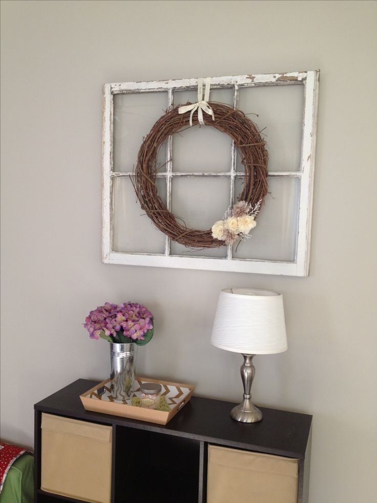 Love my latest living room wall decor...DIY wreath (wreath & flowers/supplies from AC Moore) hung over an old window...perfect!