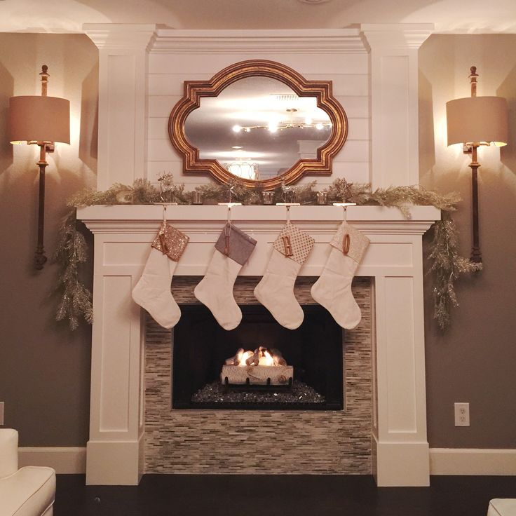 Finished our Fireplace remodel just in time for the holidays! Fireplace design, traditional transitional fireplaces, Christmas fireplace, restoration hardware lighting, Christmas stockings, cozy fireplace, birch logs, modern Christmas stockings silver and gold Christmas design @kimberlyannblank