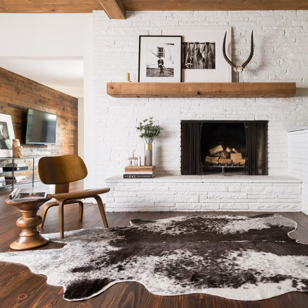Enjoy the benefits of durable synthetic fiber and instantly create a conversation starter in any room with this unusual rawhide rug. Made with 100 percent acrylic, this eye-catching Southwestern-style