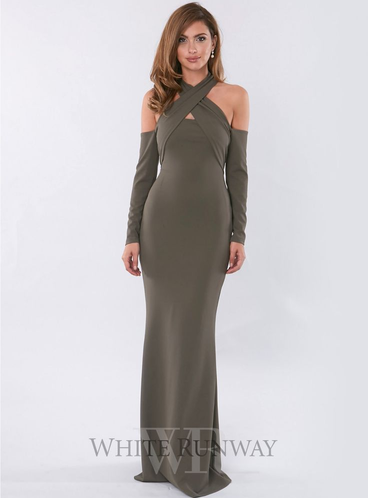 Lyric L/s Gown. A gorgeous full length dress by Pasduchas. A halter style featuring long sleeves with cut-outs on the shoulders.