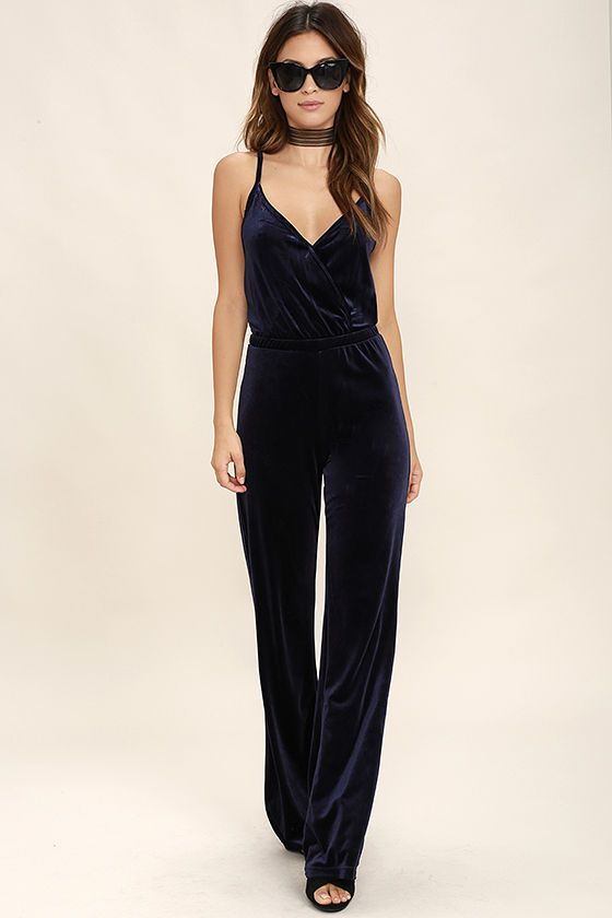 When the pressure's on to look your best, pick the BB Dakota Pearson Navy Blue Velvet Jumpsuit! Luscious stretch velvet wraps into a surplice bodice (with modesty snap) supported by adjustable straps. Elasticized waist offers a perfect fit above wide pant legs.