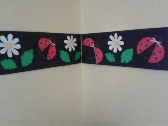 Guarda para pared del aula..diseño de vaquitas de San Antonio,margaritas y hojitas.