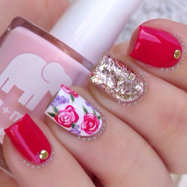 Red nails with gold giltter and floral nail art