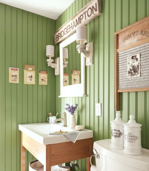 """Our bathroom walls—painted Bunker Hill by Benjamin Moore—were inspired by green planks we found lurking under the upstairs carpeting,"" says Chris. ""I love the camp lodge vibe!"""