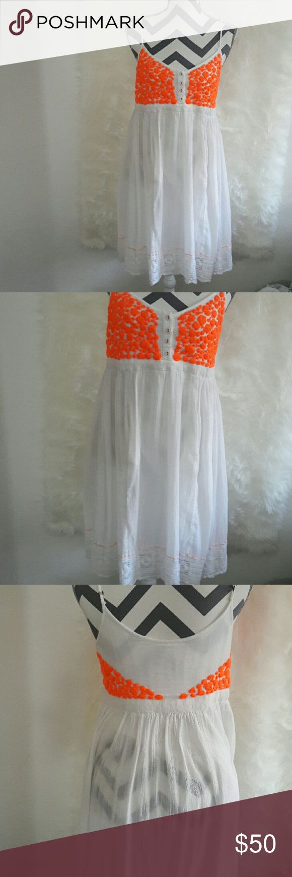 """Cute free people white flowy dress size small White , Flowy Dress With Neon Orange Embroidery And Detailing. Perfect As A Beach Dress or for the summer  And Even Has Pockets. Length """"35inches 100%cotton Free People Dresses Midi"""