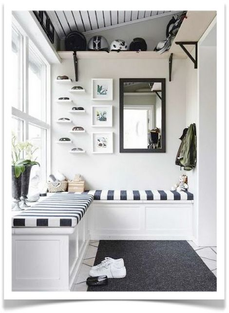 mudroom with striped beach-style cushions and L shaped bench, lots of light, nook