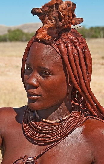 """""""Himba People""""  The Himba people are an ethnic group of about 20,000 to 50,000 people living in northern Namibia. The women are famous for covering themselves with otjize, a mixture of butter fat and ochre, possibly to protect themselves from the sun. This symbolizes earth's rich red color and the blood that symbolizes life, and is consistent with the Himba ideal of beauty.  Sesfontein, Kaokoland, Namibia, Africa  © Konstantinos Arvanitopoulos Photography. All Rights Reserved."""