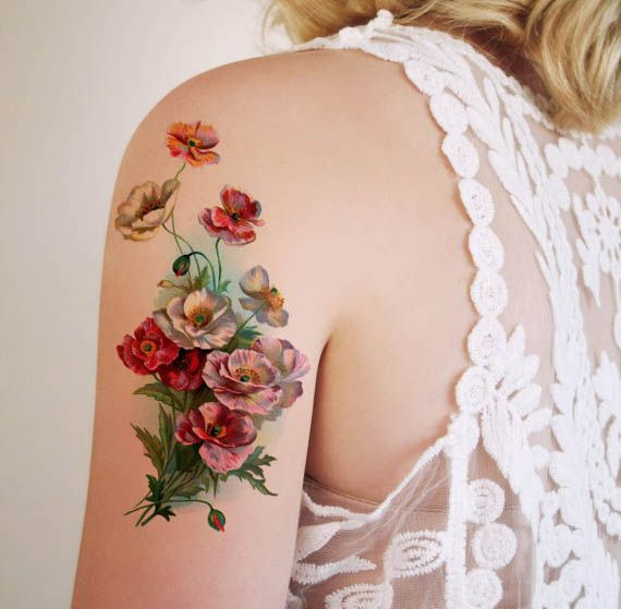 a gorgeous floral tattoo by tattoorary.