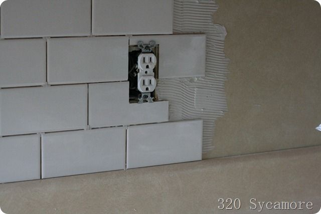 DIY:   How to Install a Subway Tile Backsplash - including how to cut around outlets. This post has excellent instructions - via 320 Sycamore