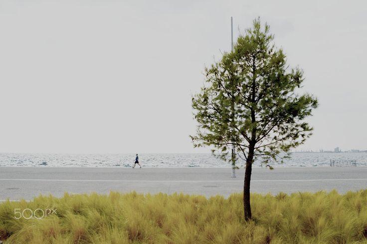 Man walking on the waterfront of Thessaloniki, Greece.