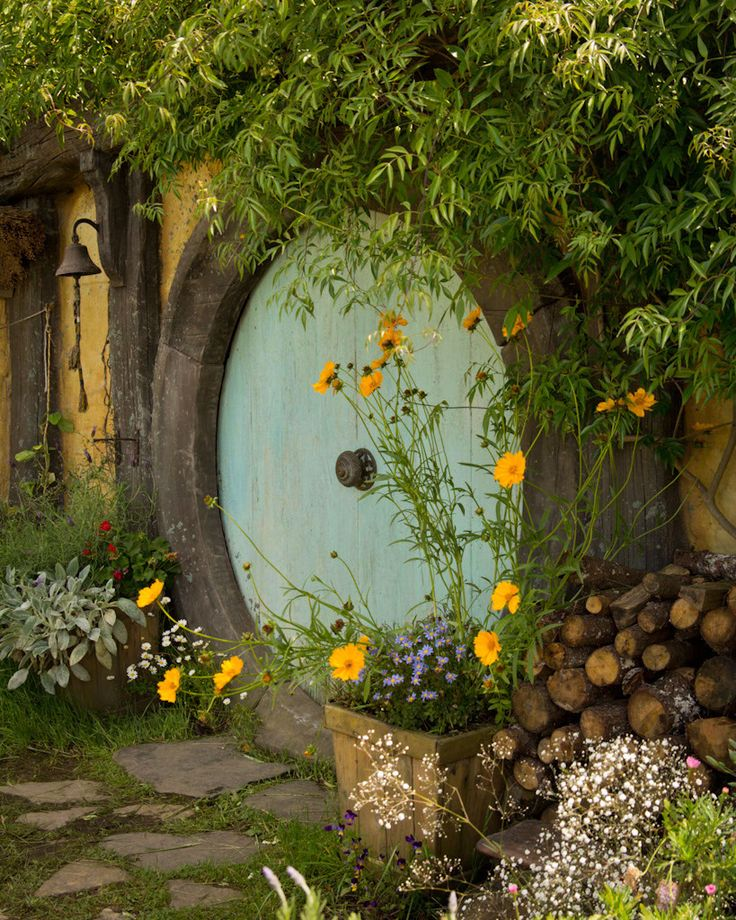 A Hobbit Hole. This would be an awesome play house for kids instead of a tree house