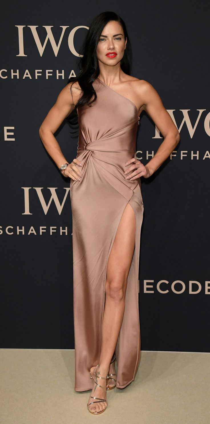 Adriana Lima brought supermodel-dom to the IWC Schaffhausen 'Decoding the Beauty of Time' Gala Dinner in a sexy one-shoulder, high-slit satin gown by Cushnie et Ochs and metallic Stuart Weitzman strappy sandals.