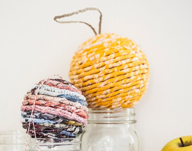 Use twisted magazine pages to DIY these fun wrapped ornaments.
