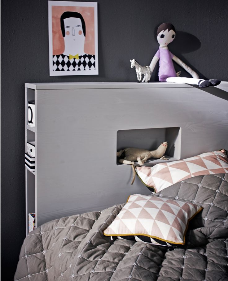 A headboard with built-in storage is a great way to save space and keep bedtime essentials close by!