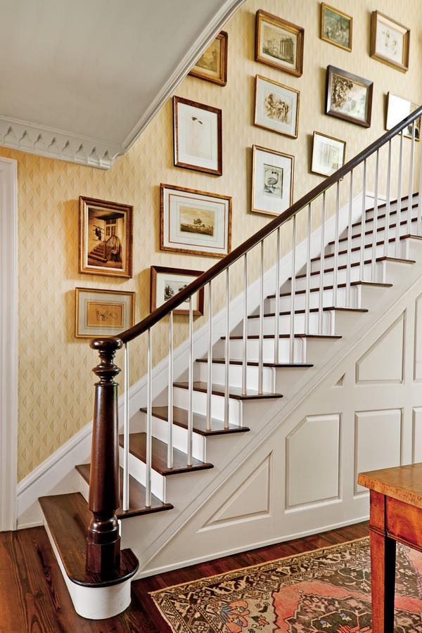 Hang Art in a Stairwell - Foolproof Formulas for Home Decorating - Southernliving. Phoebe shares her easy tips for how to display art in a stairwell.  Learn the Formula for Hanging Art in a Stairwell
