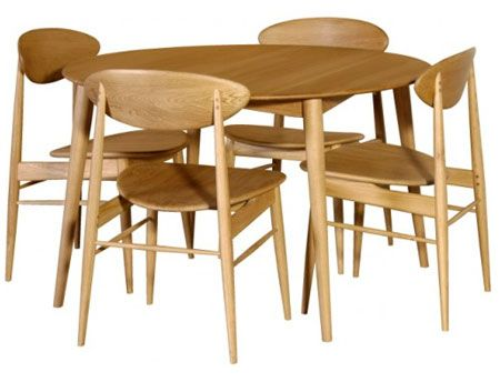 Functional, as well as offering a nod to the 1950s. that's this midcentury-style dining table and chairs at Dooley's Furniture. inspired by midcentury Scandinavian pieces, offering up that retro twist without throwing it in your face. All made of oak, you get the table with that slanted legs and lacquered finish, plus the chairs, with the same finish, but with curved backs and slightly angled seats.    The entire set is yours for £825. You can also buy the table and chairs separately.