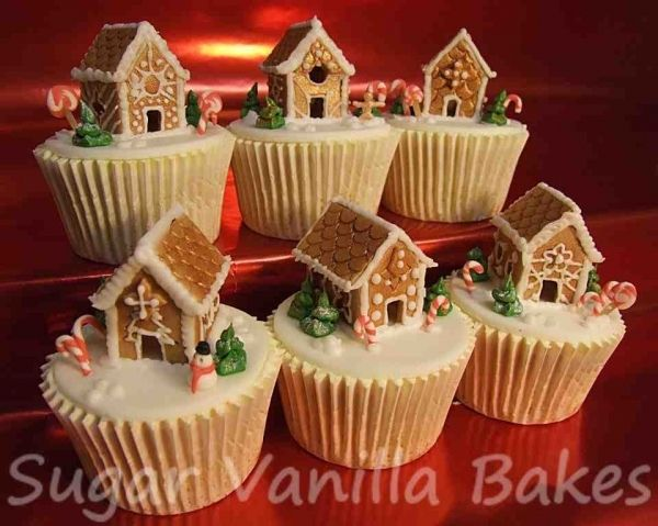 gingerbread house cupcakes -- mini gingerbread village on a big cake, yes
