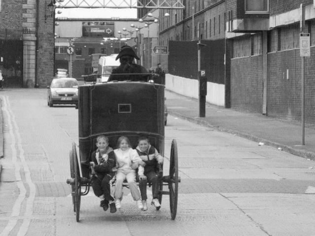 "Dublin History - ""Scuttin"" was a Dublin pastime. Here we see some ""scuttin"" on School Street #Dublin"