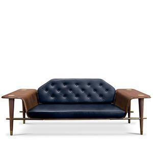 Perfect for a private lounge, Curtis settee is a modern sofa with a long wooden bench produced in dark walnut. It has a single back cushion, upholstered with a tufted leather, as well as two arms that can be used as side tables. It also features a round tapered leg with polished brass feet that create a contrast with its dark tones.