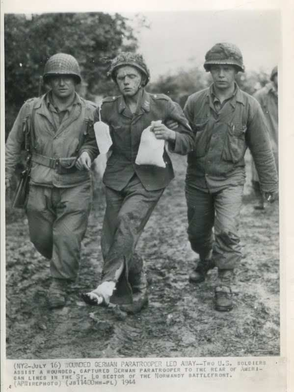 Fallschirmjäger prisonner and wounded, near St. Lo , july 1944, Normandy, France.