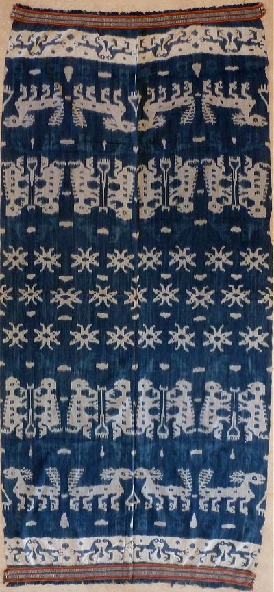 "Ikat from Sumba, Sumba, Indonesia.  - ""Average blue Sumba with a strong pattern, and decent weaving. This type of hinggi is typical of the kind worn by commoners, other colours being forbidden to them."""