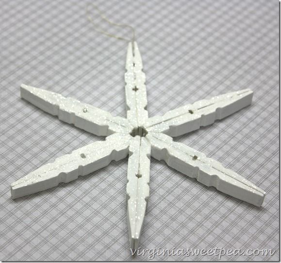 Snowflake Ornament from Clothespins - Sweet Pad You will need six clothespins to make an ornament. Dollar stores sell clothespins! Save $$ have fun!
